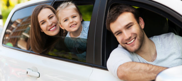 happy family posing inside their new car