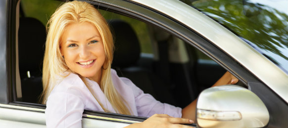 blonde girl driving her car