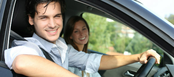 happy couple in road trip via their car hire