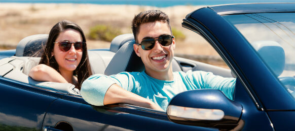 couple inside a blue hire car