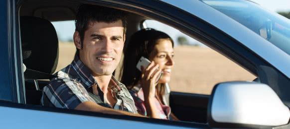 couple inside their new car