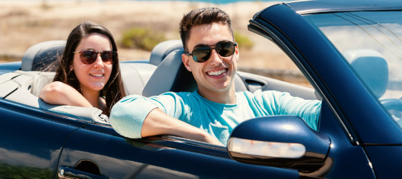 couple posing inside their car hire