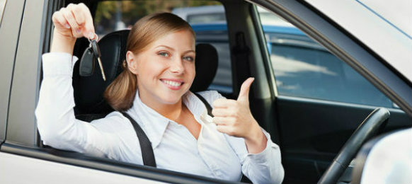 Girl smiling while showing her car hire key