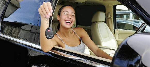 happy woman holding her car key