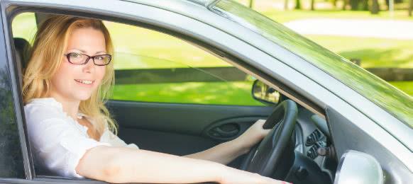 intellectual woman driving a car rental