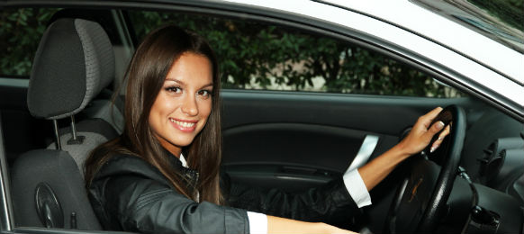 lady smiling inside car rental
