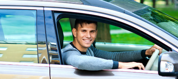 man driving his rental car with a girl