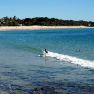 man surfing at noosa heads beach