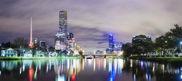 skyscrapers night view along Yarra River in Melbourne