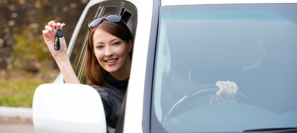 excited woman ready to drive her car hire in lidcombe