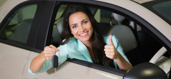 woman holding a car rental key