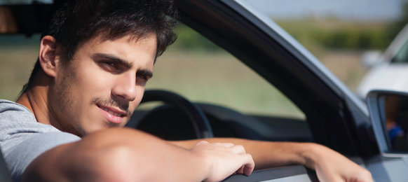 young man waiting in the car